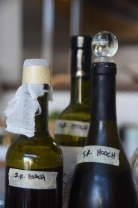 Flower + Bone – Bottles of homemade hooch