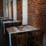 Flower + Bone – Brick wall tables with napkins and glasses