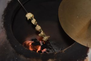 Flower + Bone – Pork on skewer over hot coals in clay oven