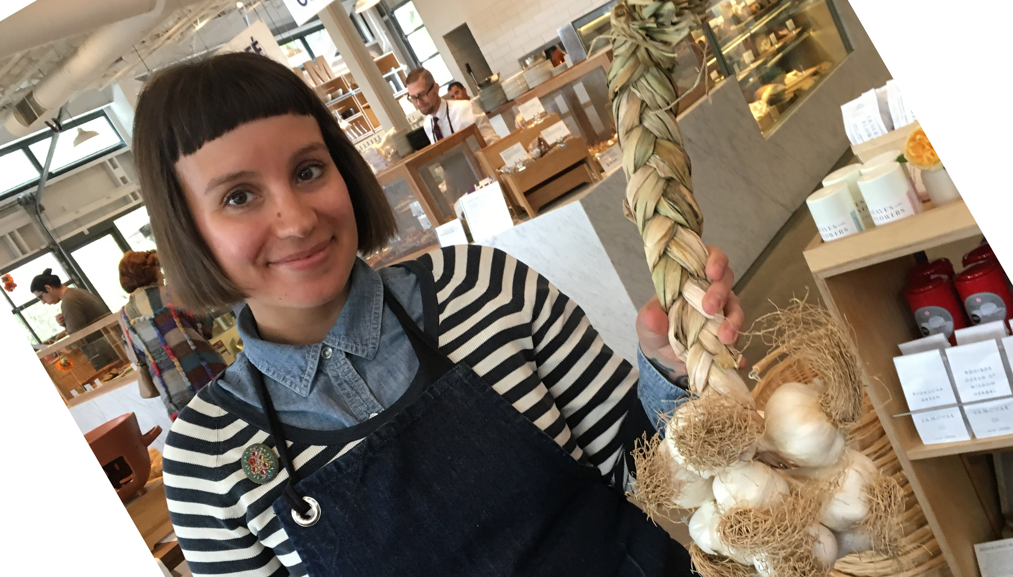 Meg Rottinghaus at Healdsburg SHED holding Yael's braided garlic